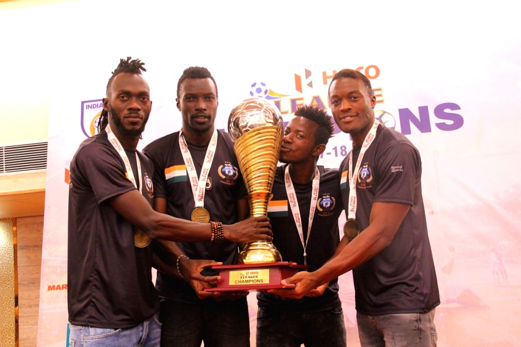 Bazie Armand, Kassim Aidara and Guy Eric Dano of Minerva Punjab FC during the presentation ceremony of I-League in Chandigarh on March 22, 2018. Minerva Punjab FC created history by ...