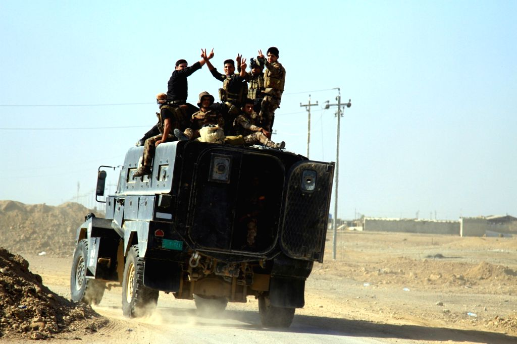 BAZWAIA, Oct. 31, 2016 - Iraq's counter-terrorism forces assemble to launch attacks on the city of Mosul in Bazwaia town, on the eastern outskirts of Mosul, Iraq, on Oct. 31, 2016. Iraqi security ...