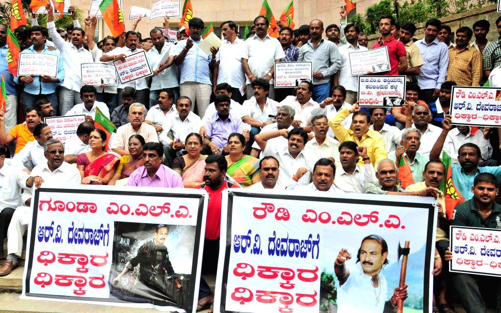 BBMP BJP councillors demonstrate against Congress legislator RV Devraj in Bangalore on Aug 21, 2014.
