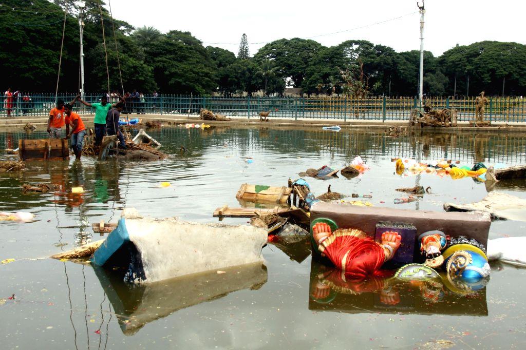 BBMP workers clean Ulsoor Lake after Ganesha immersions in Bengaluru Sept 11 2016.
