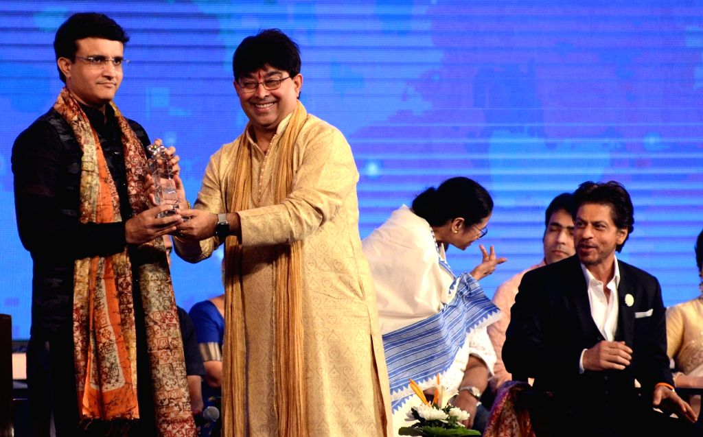 BCCI President Sourav Ganguly being welcomed the inaugural session of 25th Kolkata International Film festival, in Kolkata on Nov 8, 2019. Also seen West Bengal Chief Minister Mamata ... - Mamata Banerjee, Sourav Ganguly and Rukh Khan