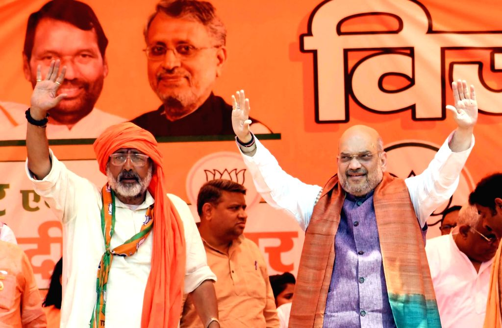 Begusarai: BJP chief Amit Shah with Union Minister and the party's Lok Sabha candidate from Begusarai, Giriraj Singh during a public rally in Bihar's Begusarai, on April 24, 2019. (Photo: IANS) - Amit Shah and Giriraj Singh