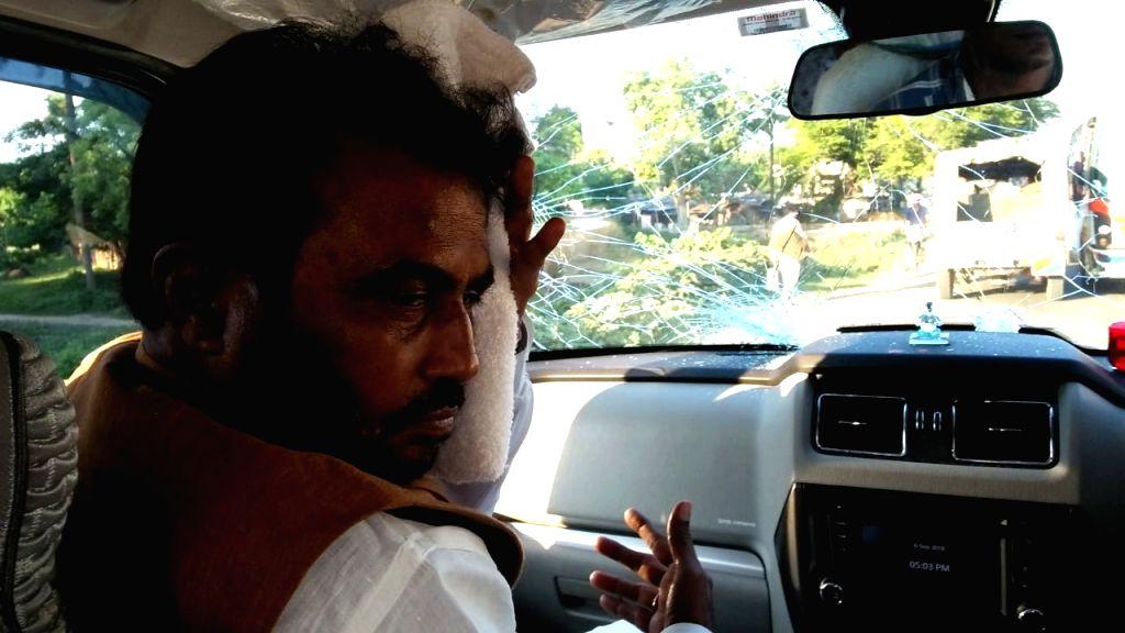 Begusarai: JDU leader Shyam Rajak in his car that was attacked in Begusarai of Bihar on Sept 6, 2018. (Photo: IANS)