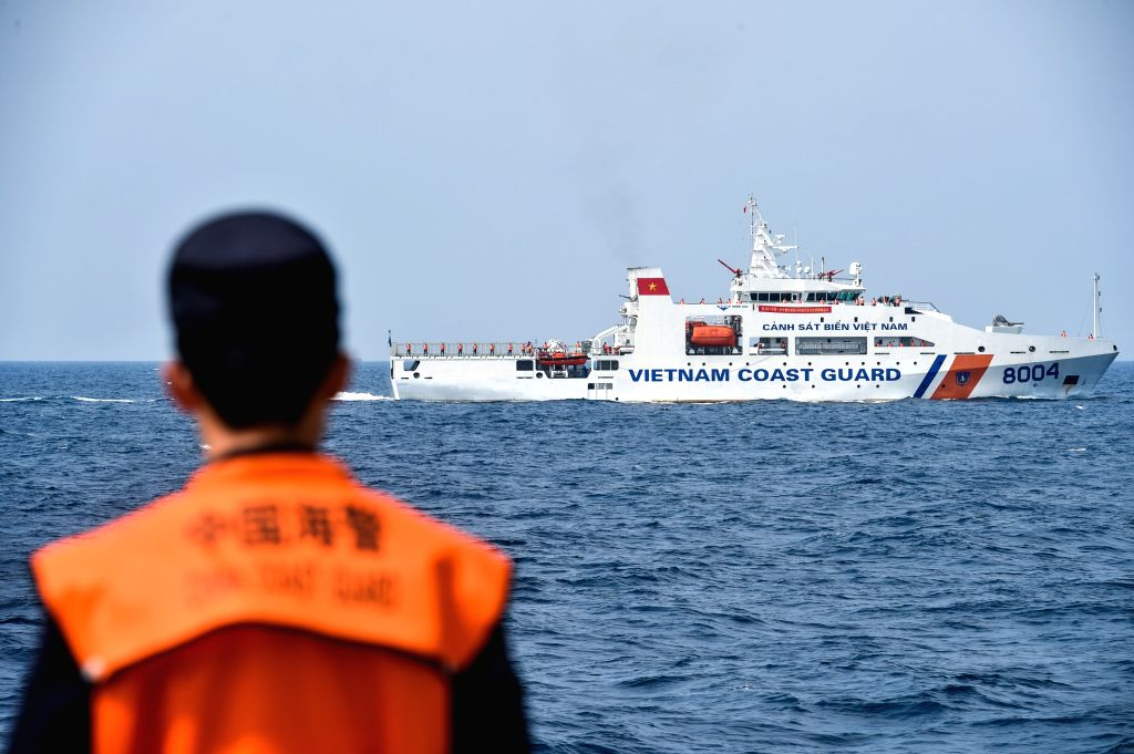 BEIBU GULF, April 18, 2017 - Maritime police vessels from China and Vietnam attend a joint fishery inspection in the Beibu Gulf, April 18, 2017. China and Vietnam started a joint fishery inspection ...