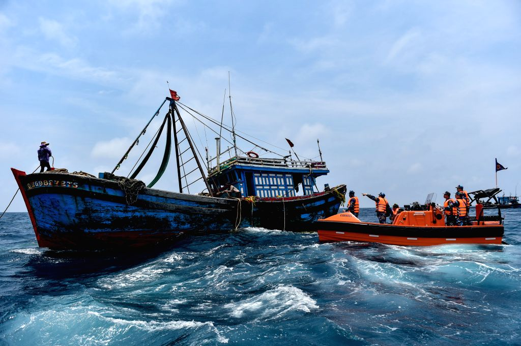 BEIBU GULF, April 18, 2017 - Maritime policemen from Vietnam is to inspect a Vietnamese fishing boat during a joint fishery inspection in the Beibu Gulf, April 18, 2017. China and Vietnam started a ...
