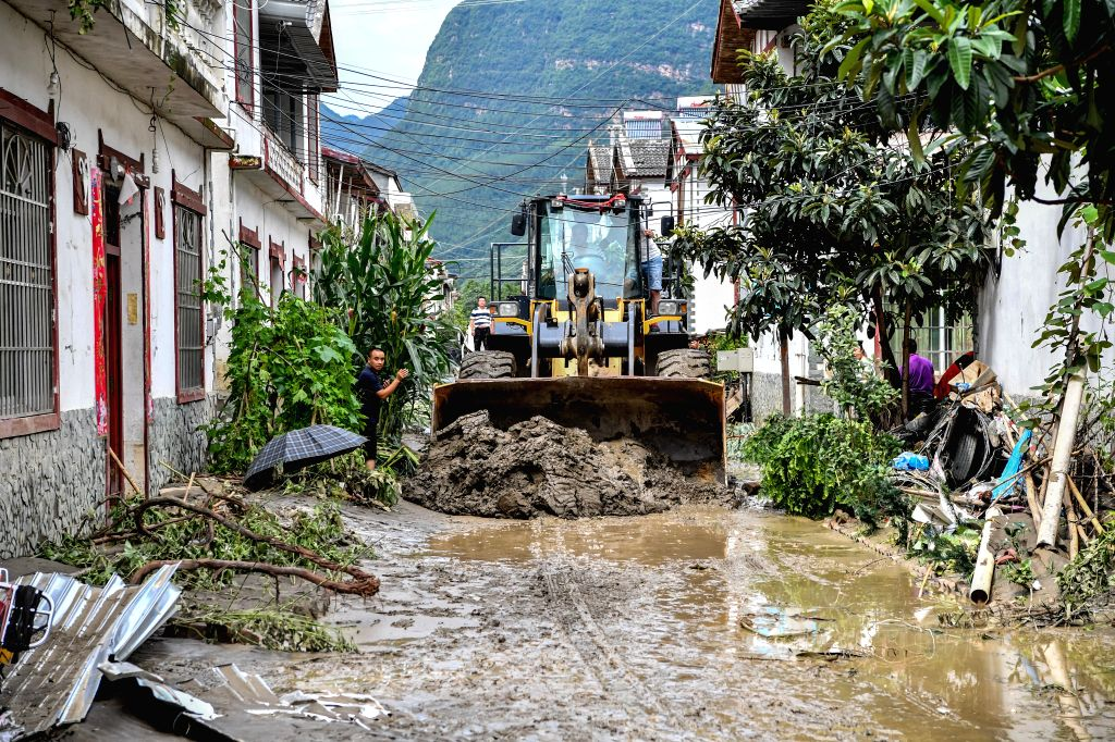 BEICHUAN, July 12, 2018 - People clear mud on the street in Chenjiaba Town of Beichuan County, southwest China's Sichuan Province, July 12, 2018. Lasting torrentials in the past days have caused ...