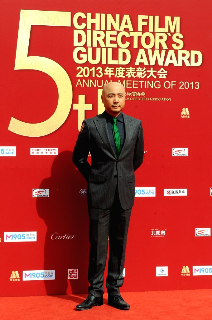 Actor Xu Zheng takes part in the 2013 annual commendation conference of China Film Directors Guild in Beijing, capital of China, April 9, 2014. - X