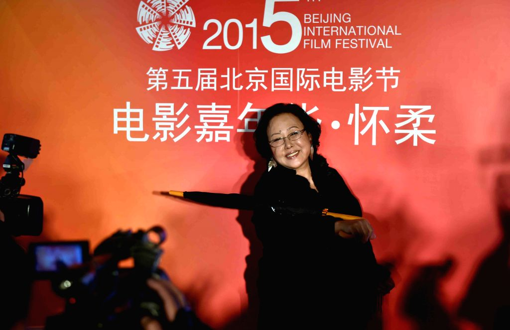 Actress Siqin Gaowa attends the opening ceremony of the film carnival of Beijing International Film Festival at the Yanqi Lake scenic area in Beijing, capital of ... - Siqin Gaowa