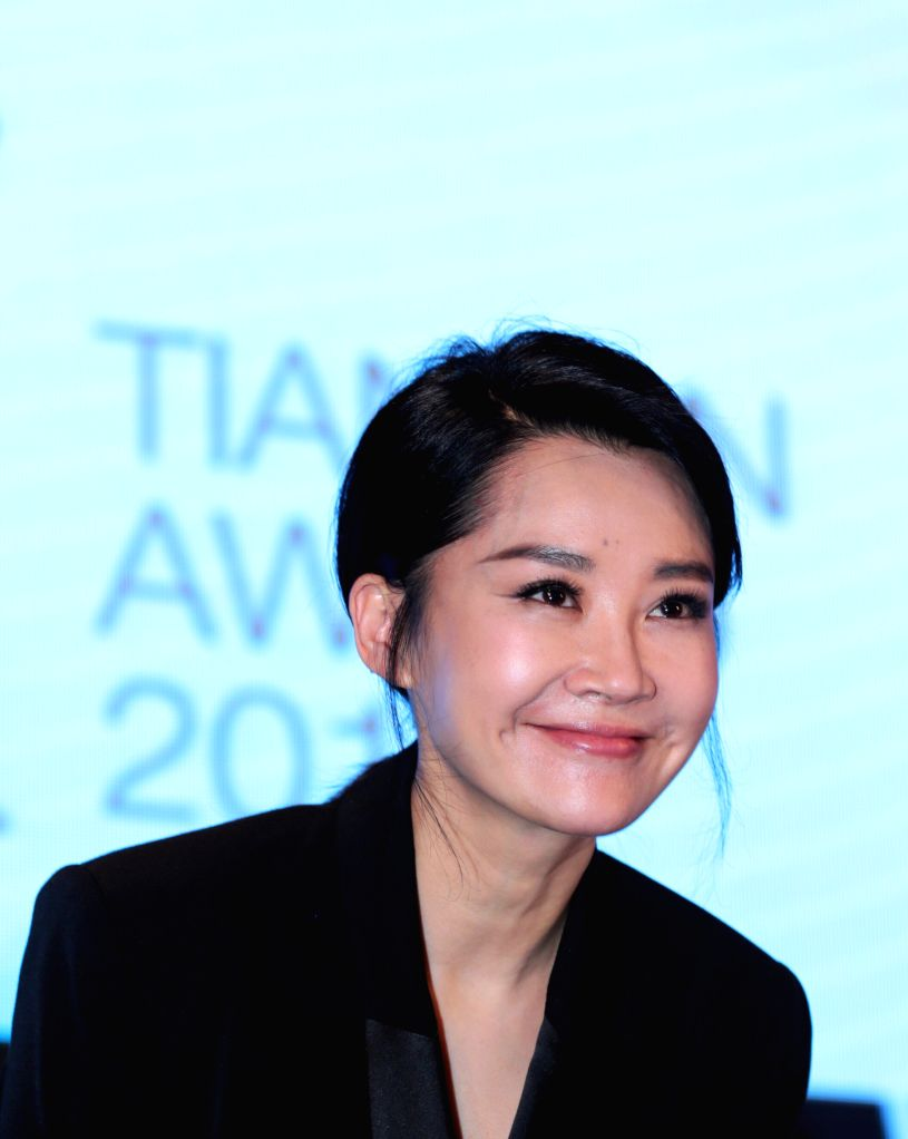 BEIJING, April 15, 2016 - Chinese actress Xu Qing reacts during a press conference of the international jury of Tiantan Award of the 6th Beijing International Film Festival in Beijing, capital of ... - X