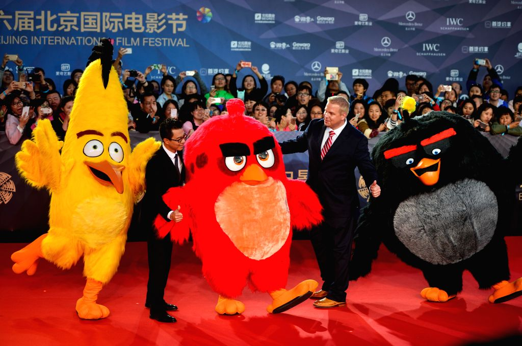 """BEIJING, April 16, 2016 - Cast members and cartoon figures of the movie """"Angry Birds"""" walk the red carpet as they attend the opening ceremony of the 6th Beijing International Film Festival ..."""