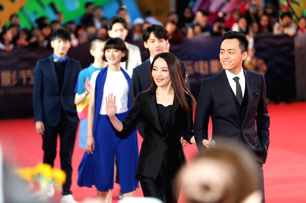 """BEIJING, April 16, 2016 - Cast members of the movie """"Yesterday Once More"""" walk the red carpet as they attend the opening ceremony of the 6th Beijing International Film Festival (BJIFF) in ..."""
