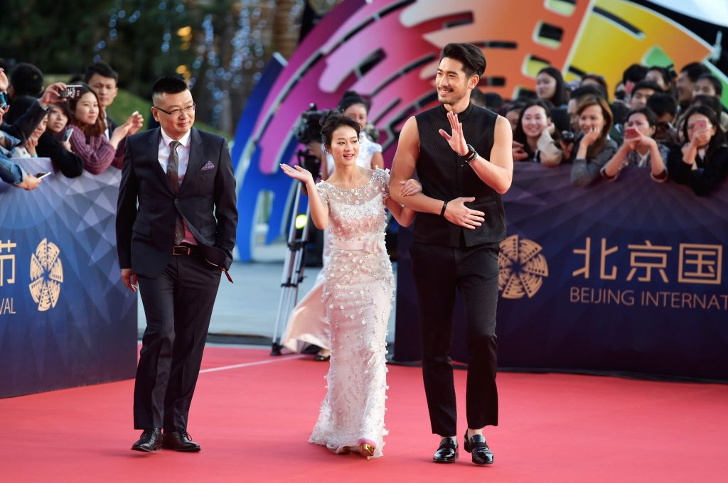 """BEIJING, April 16, 2016 - Cast members of the movie """"Min & Max"""" walk the red carpet as they attend the opening ceremony of the 6th Beijing International Film Festival (BJIFF) in ..."""