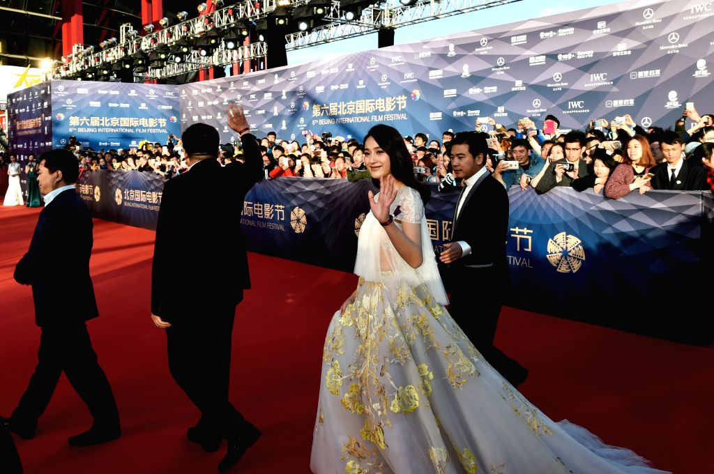"""BEIJING, April 16, 2016 - Cast members of the movie """"Song of the Phoenix"""" walk the red carpet as they attend the opening ceremony of the 6th Beijing International Film Festival (BJIFF) in ..."""