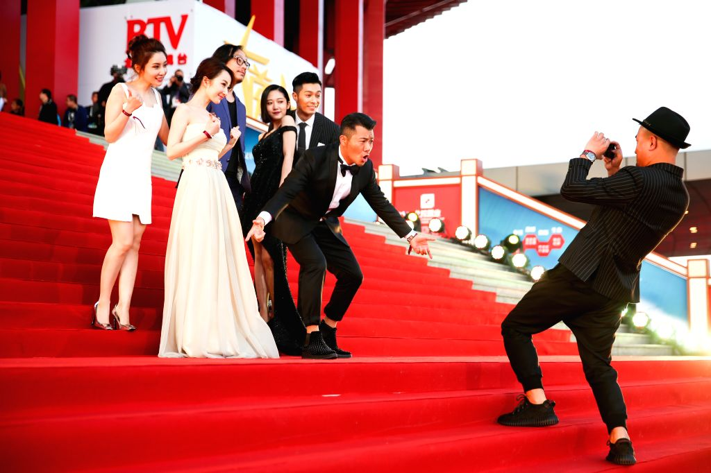 """BEIJING, April 16, 2016 - Cast members of the movie """"Delusion"""" pose on the red carpet as they attend the opening ceremony of the 6th Beijing International Film Festival (BJIFF) in Beijing, ..."""