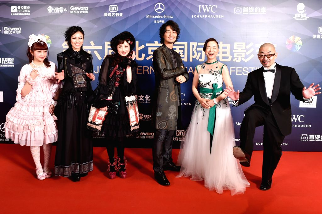 BEIJING, April 16, 2016 - Japanese guests pose on the red carpet as they attend the opening ceremony of the 6th Beijing International Film Festival (BJIFF) in Beijing, capital of China, April 16, ...