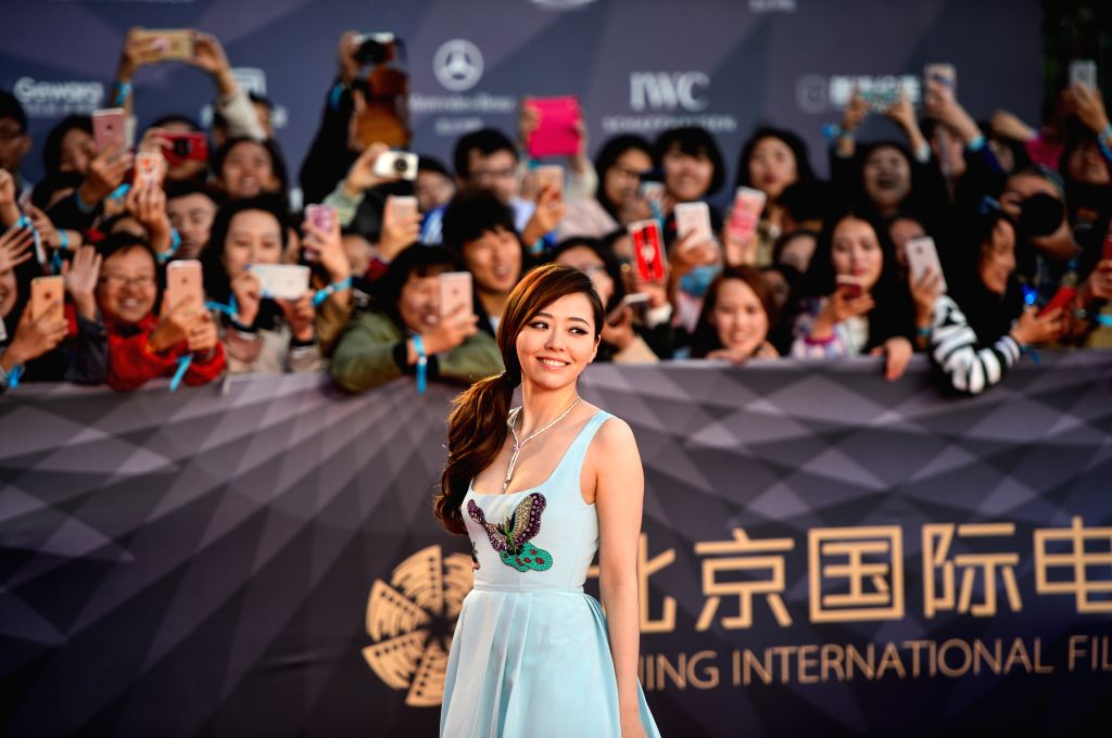 BEIJING, April 16, 2016 - Singer Zhang Liangying poses for photos as she attends a red carpet event held for the opening ceremony of the 6th Beijing International Film Festival (BJIFF) in Beijing, ...