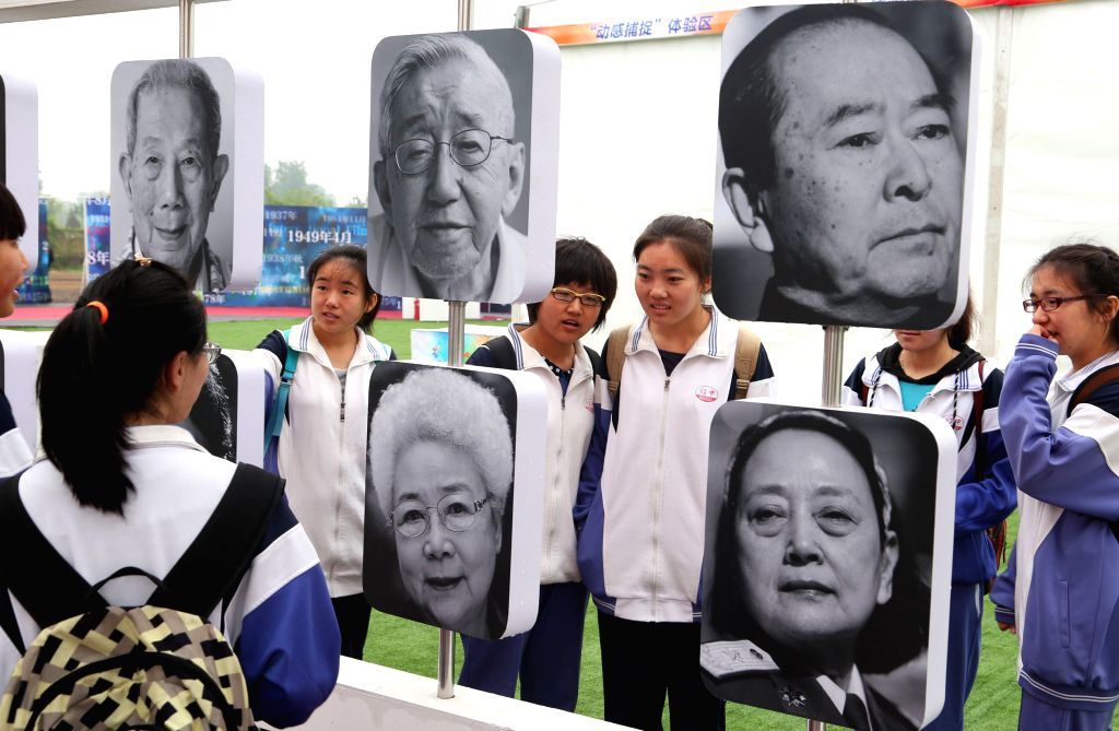 Students look at the film development exhibition at the Beijinig International Film Festival carnival in Beijing, capital of China, April 17, 2014. The seven-day ..