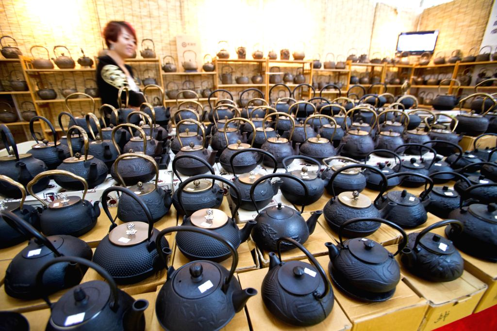 Japanese iron teapots are displayed at the fourth China International Tea and Tea Ceremony Exhibition in Beijing, China, April 18, 2014. The four-day tea expo ...