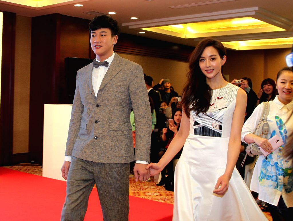 """Leading roles of """"Love Me Love My Dog"""" Peter Ho (L) and Chun-Ning Chang attend the movie's press conference as part of the 5th Beijing International Film ..."""