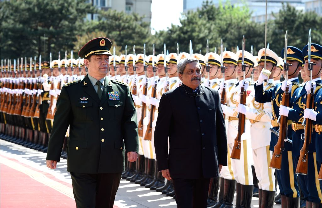 BEIJING, April 18, 2016 - Chinese State Councilor and Defense Minister Chang Wanquan (L front) and Indian Defence Minister Manohar Parrikar inspect the guard of honour in Beijing, capital of China, ... - Chang Wanquan