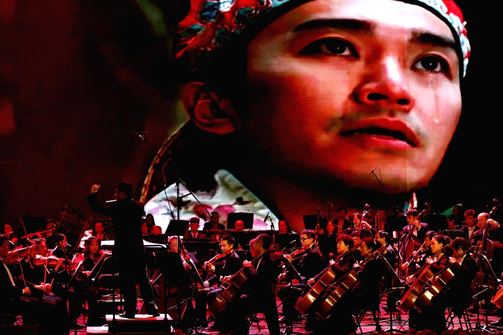 Musicians perform at the World-famous Works Film Concert during the fifth Beijing International Film Festival (BJIFF) in Beijing, capital of China, April 18, 2015. ...
