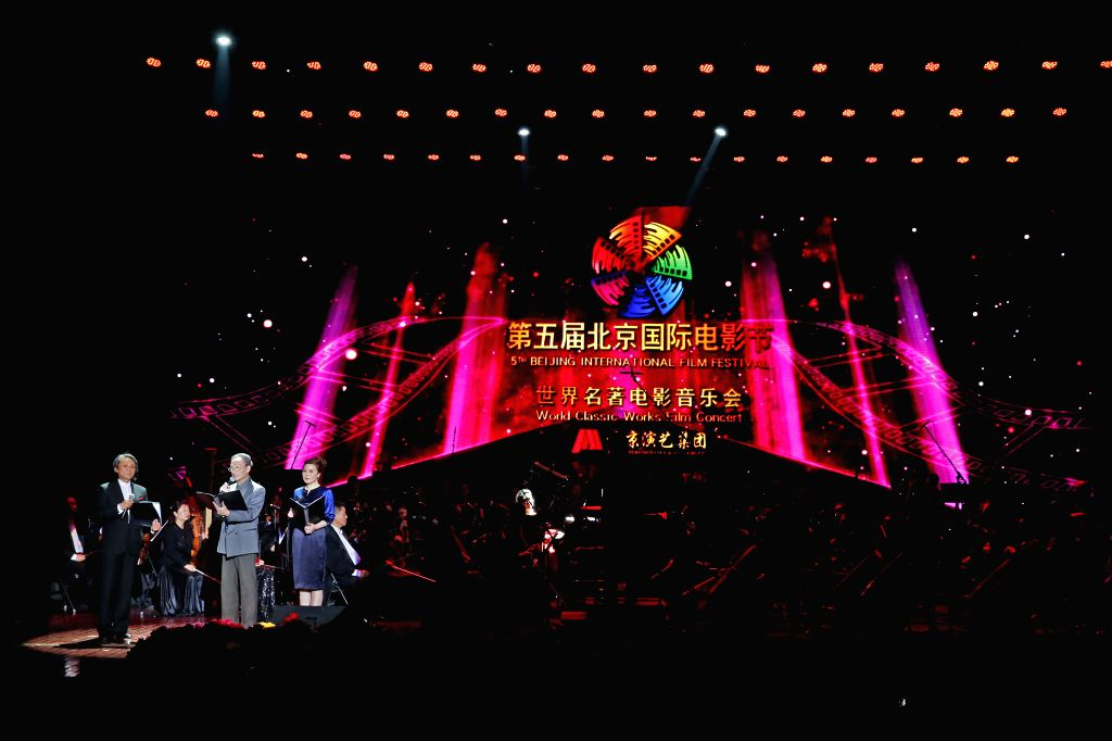 Performers recite at the World-famous Works Film Concert during the fifth Beijing International Film Festival (BJIFF) in Beijing, capital of China, April 18, 2015. ...