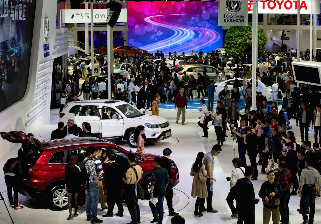 People view vehicles during the media preview of the 2014 Beijing International Automotive Exhibition in Beijing, China, April 20, 2014. The auto show will be ...