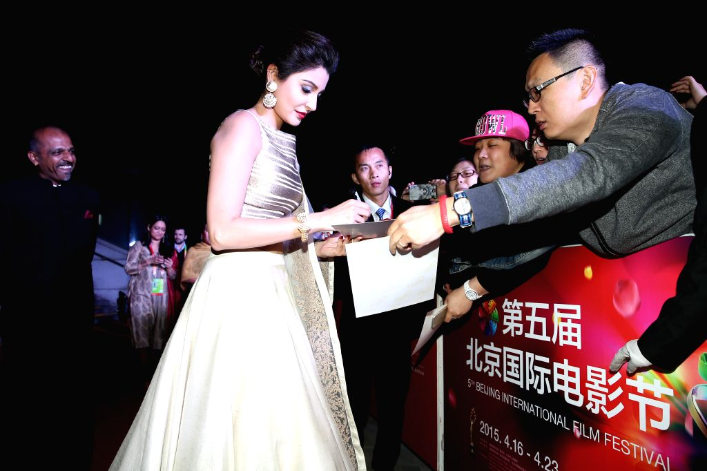 """Actress Anushka Sharma interacts with fans during the premiere of the film """"NH10"""" for the competition section at the fifth Beijing International Film ... - Anushka Sharma"""