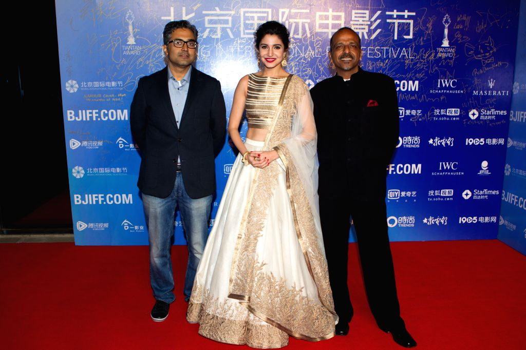"""Director Navdeep Singh (R) and actress Anushka Sharma (C) attend the premiere ceremony of the film """"NH10"""" for the competition section at the fifth ... - Anushka Sharma and Navdeep Singh"""