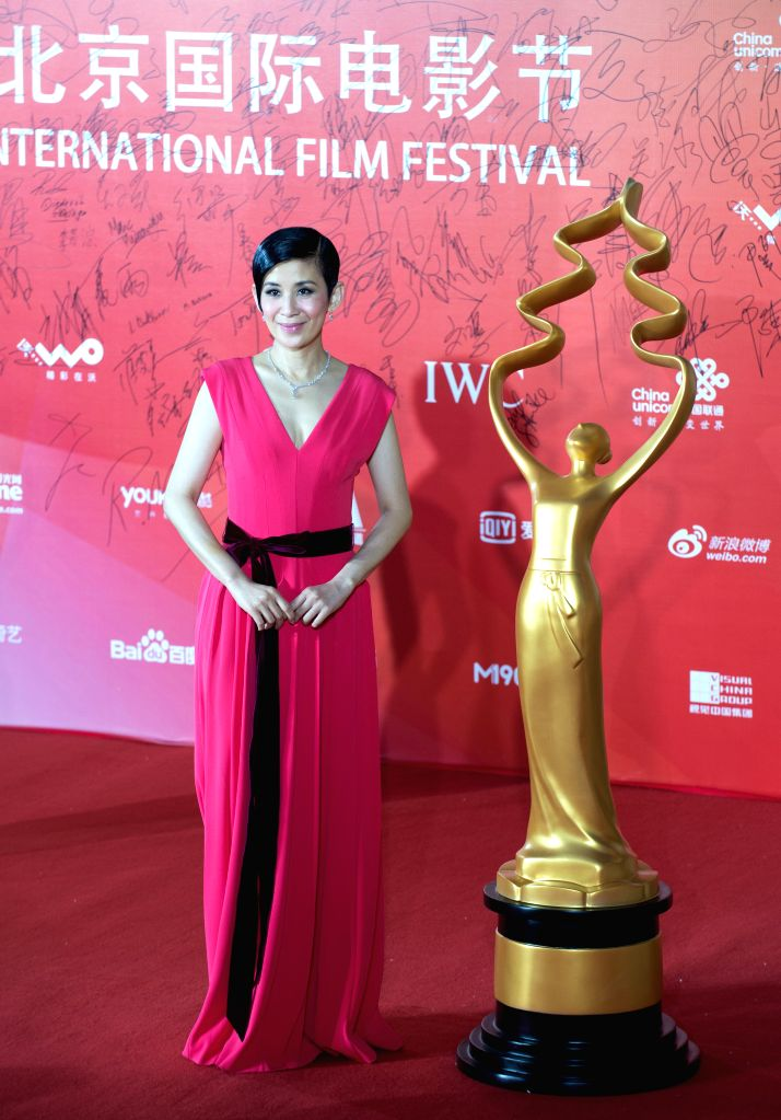Actress Sandra Ng poses at the red carpet during the closing ceremony of the 4th Beijing International Film Festival in Beijing, capital of China, April 23, 2014. - Sandra N