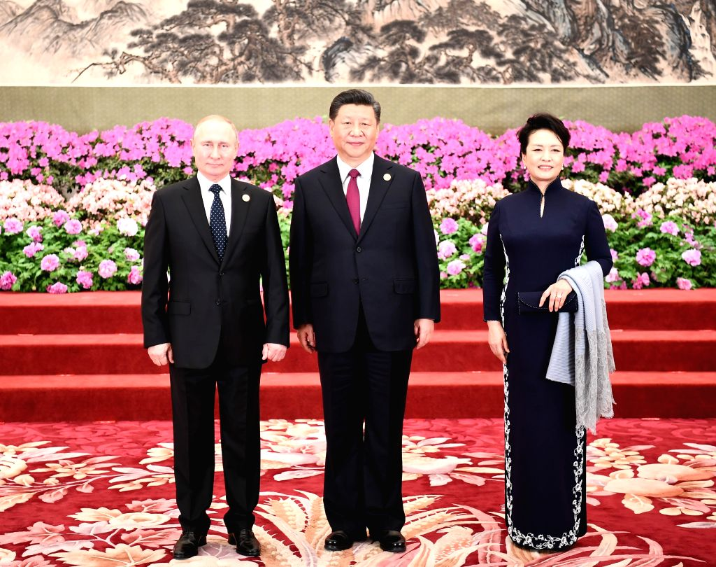 BEIJING, April 26, 2019 - Chinese President Xi Jinping and his wife Peng Liyuan welcome Russian President Vladimir Putin before a banquet in honor of guests attending the Second Belt and Road Forum ...
