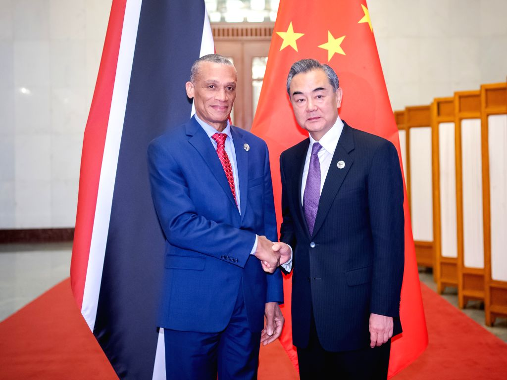 BEIJING, April 26, 2019 - Chinese State Councilor and Foreign Minister Wang Yi (R) meets with Trinidad and Tobago's Foreign Minister Dennis Moses in Beijing, capital of China, April 26, 2019. - Wang Y