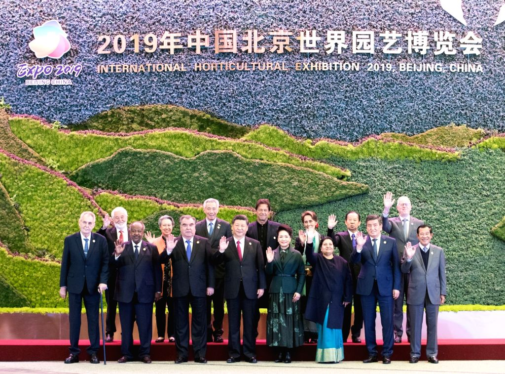 BEIJING, April 28, 2019 - Chinese President Xi Jinping and his wife Peng Liyuan pose for a group photo with foreign leaders before the opening ceremony of the International Horticultural Exhibition ...