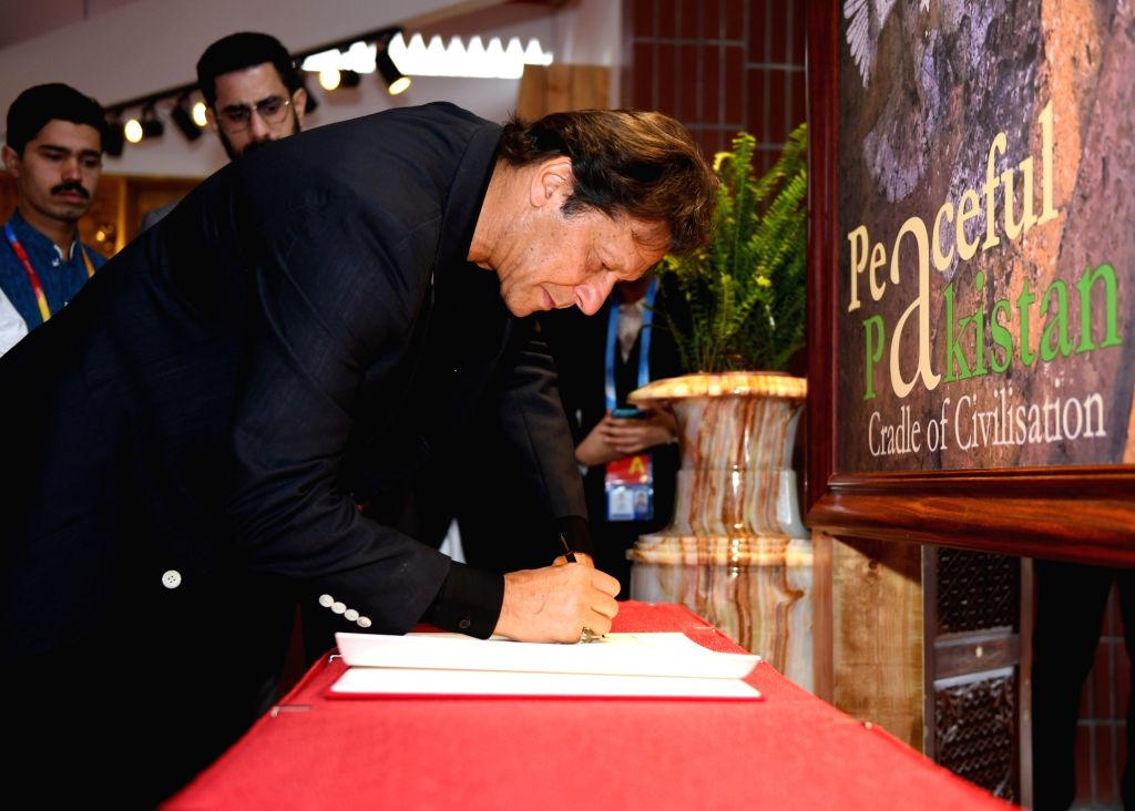 BEIJING, April 28, 2019 - Pakistani Prime Minister Imran Khan signs autograph as he visits the Pakistan Garden at the International Horticulture zone of the International Horticultural Exhibition ... - Imran Khan