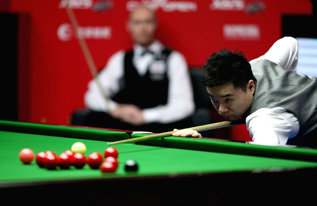 China's Ding Junhui competes during his semifinal against England's Gary Wilson at the 2015 World Snooker China Open in Beijing, capital of China, April 4, 2015. ...