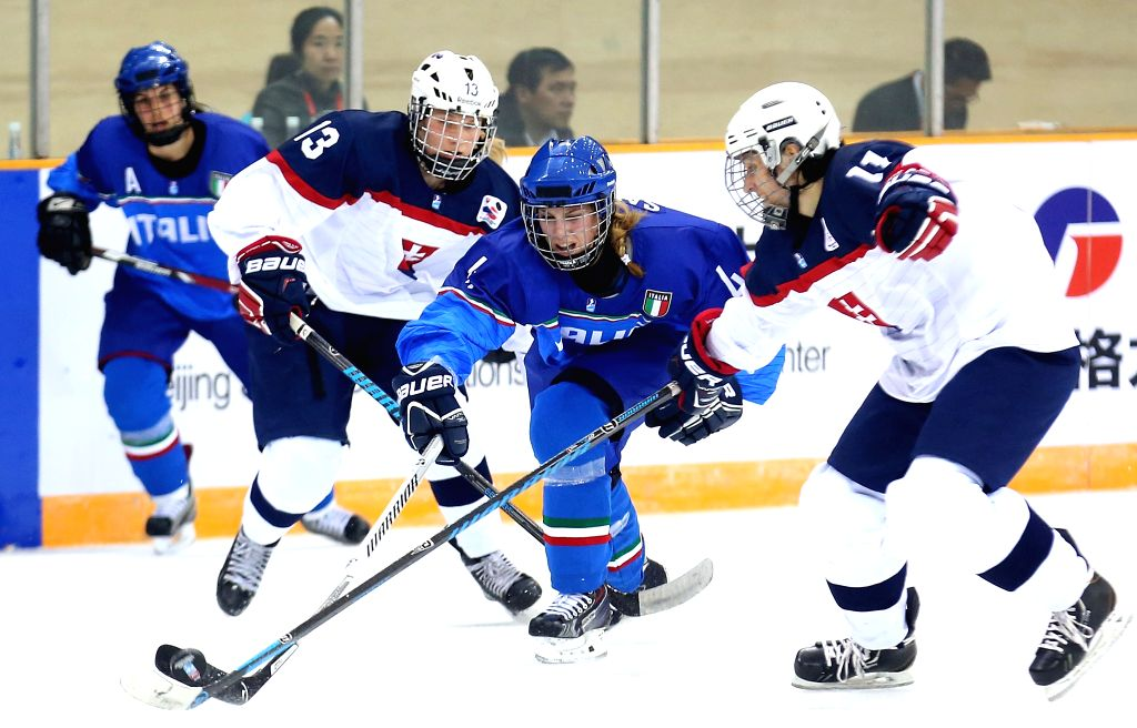 Carola Saletta (2nd R) of Italy competes during the 2015 IIHF Ice Hockey Women's World Championship Division 1 Group B match between Slovakia and Italy, in Beijing, ...