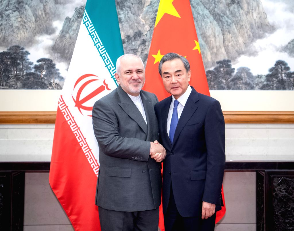 BEIJING, Aug. 26, 2019 - Chinese State Councilor and Foreign Minister Wang Yi (R) holds talks with Iranian Foreign Minister Mohammad Javad Zarif in Beijing, capital of China, Aug. 26, 2019. - Wang Y