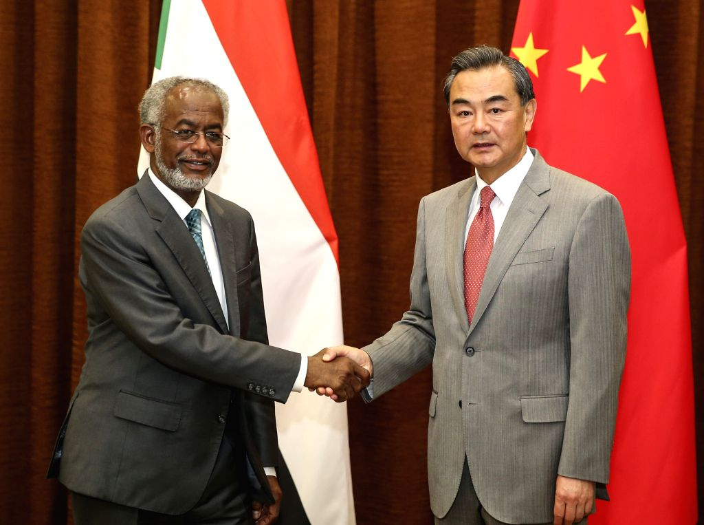 Chinese Foreign Minister Wang Yi (R) meets with his Sudanese counterpart Ahmed Ali Karti in Beijing, capital of China, Aug. 27, 2014.