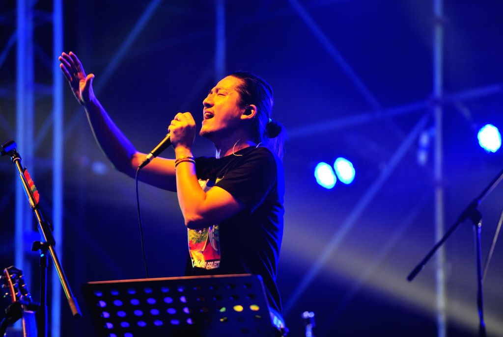 Singer Peng Tan performs at the Modern Music Festival in Beijing, capital of China, Aug. 29, 2014. The music festival, which kicked off on Aug. 29, will last until .