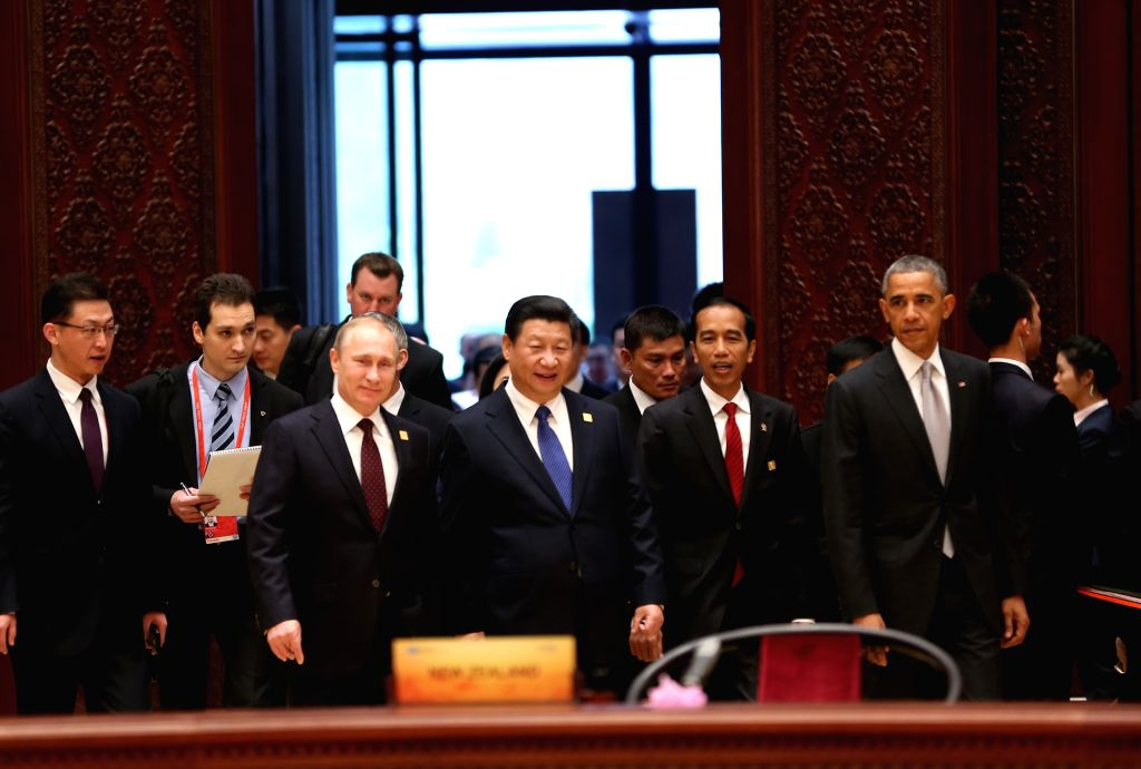 Beijing (China): Chinese President Xi Jinping (front C), U.S. President Barack Obama (1st R, front), Indonesian President Joko Widodo (2nd R, front), Russian President Vladimir Putin (front L) and ...