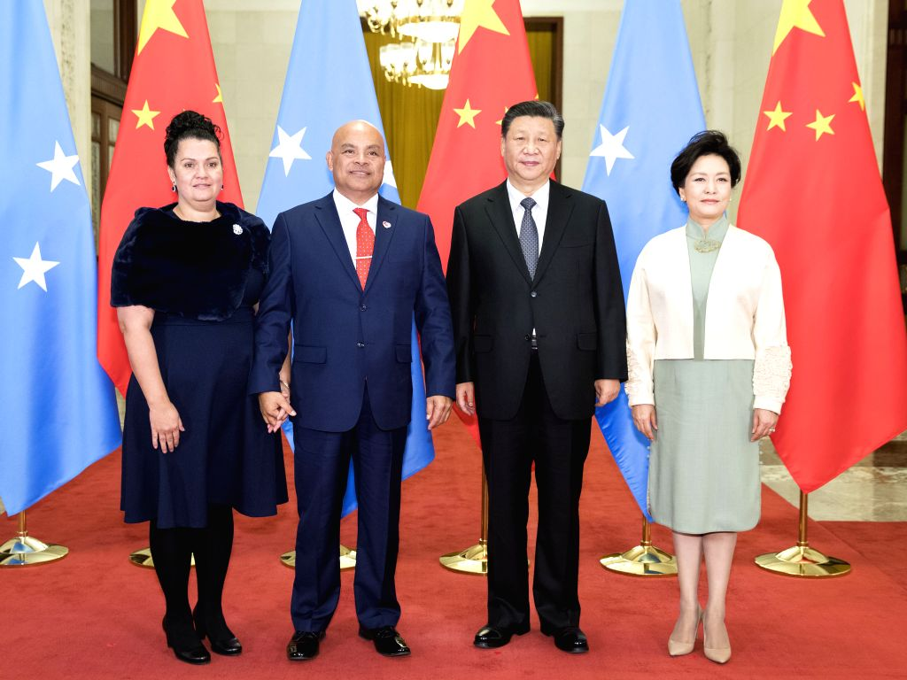 BEIJING, Dec. 13, 2019 - Chinese President Xi Jinping and his wife Peng Liyuan pose for photos with President of the Federated States of Micronesia David W. Panuelo and Ms. Patricia Edwin in Beijing, ...