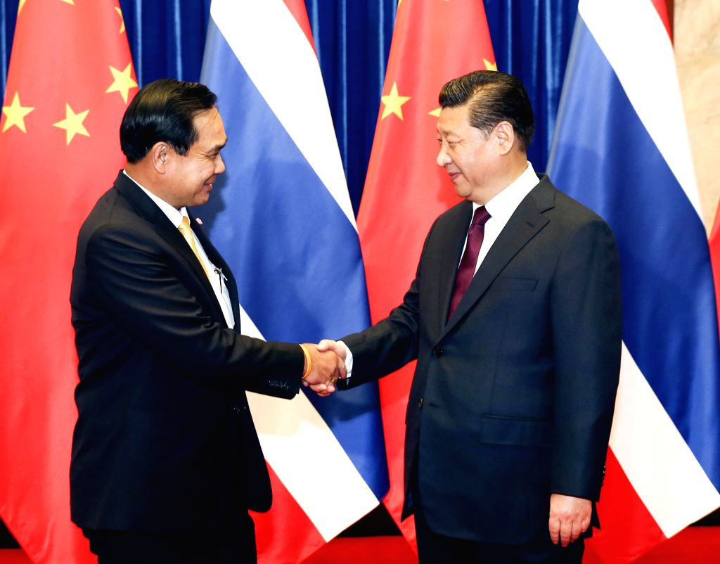 Chinese President Xi Jinping (R) meets with Thai Prime Minister Prayuth Chan-ocha in Beijing, capital of China, Dec. 23, 2014. - Prayuth Chan