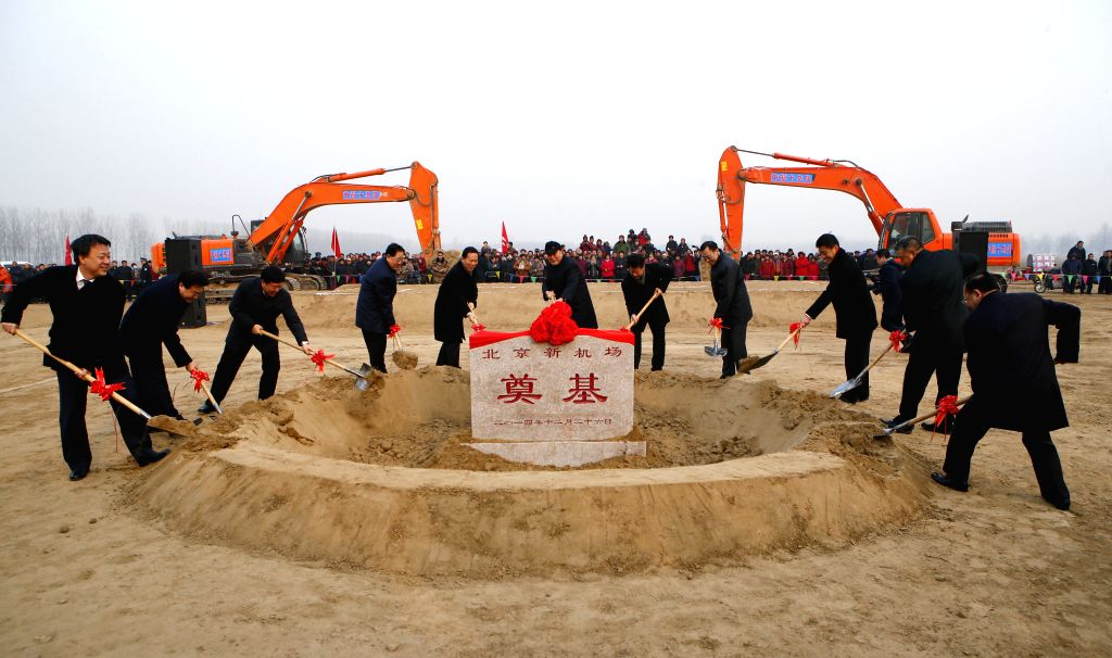 The ground breaking ceremony of Beijing's new airport is held in the Daxing District of Beijing, capital of China, Dec. 26, 2014. The airport is designed to handle .
