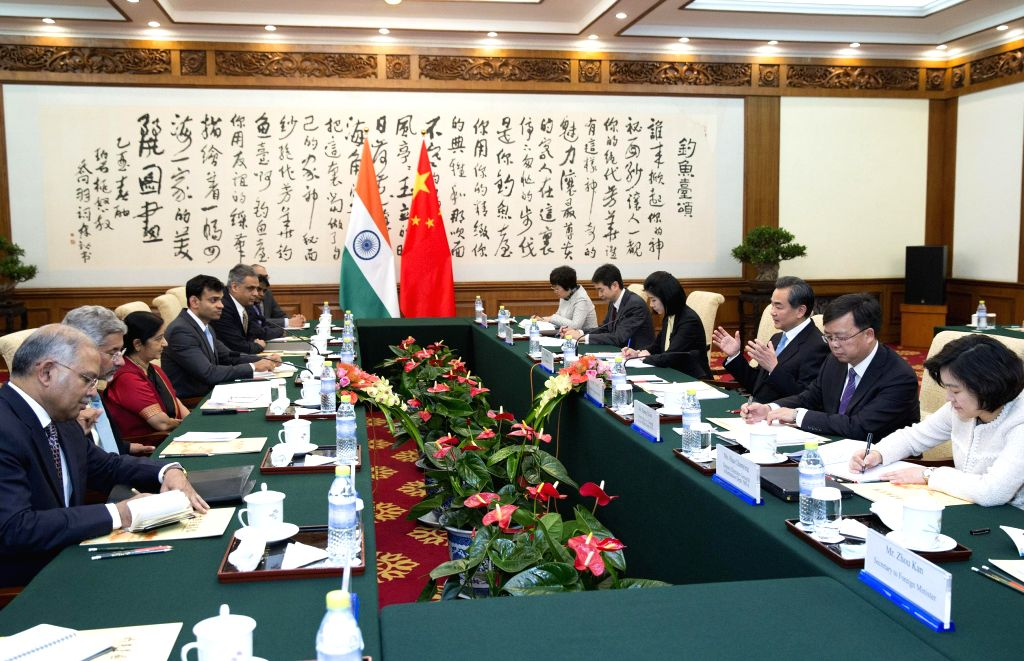 Chinese Foreign Minister Wang Yi (3rd R) meets with his Indian counterpart Sushma Swaraj (3rd L) in Beijing, China, Feb. 1, 2015. - Wang Y and Sushma Swaraj