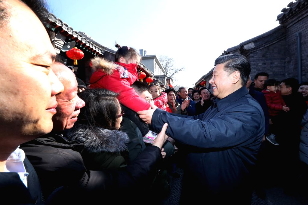 BEIJING, Feb. 1, 2019 - Chinese President Xi Jinping, also general secretary of the Communist Party of China Central Committee and chairman of the Central Military Commission, greets residents as he ...