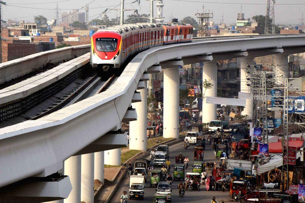 BEIJING, Feb. 7, 2019 - Photo taken on May 16, 2018 shows the Orange Line Metro Train (OLMT) during a test run in eastern Pakistan's Lahore. Pakistani Prime Minister Imran Khan said on Wednesday that ... - Imran Khan