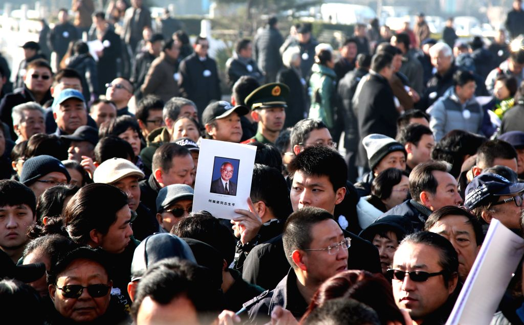 People attend a farewell ceremony for He Zhengliang, former International Olympic Committee (IOC) member and vice president, at Babaoshan Revolutionary Cemetery in .