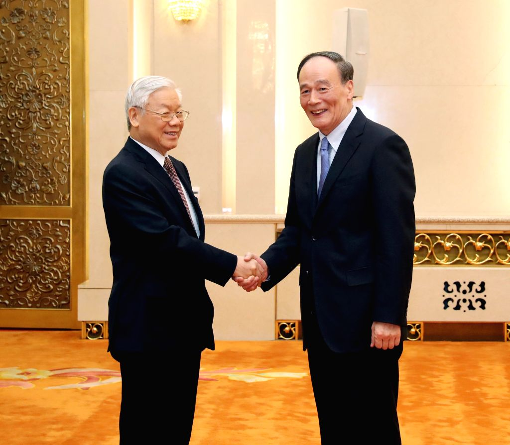 BEIJING, Jan. 13, 2017 - Wang Qishan (R), secretary of the Communist Party of China (CPC) Central Commission for Discipline Inspection, meets with Nguyen Phu Trong, General Secretary of the Communist ...