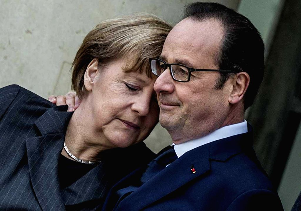 French President Francois Hollande (R) welcomes German Chancellor Angela Merkel at the Elysee Palace in Paris Jan. 11, 2015. Hollande and foreign leaders attended a