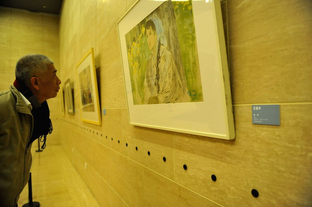 A man visits China Watercolor Art Research Exibition at the National Art Museum of China in Beijing, capital of China, Jan. 23, 2015. The exhibition opened on ...